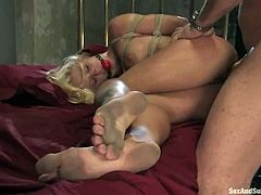 Luscious blonde girl gets tied up and fingered. Then she gives hot blowjob to her master and gets fucked hard in her tight ass.