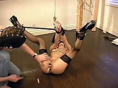 What an amazing BDSM action this is to witness. Booty and horny blond Jezzabelle is being humiliated in all the possible ways.