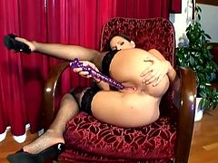 What a sex creature she is! Eve Angel got a perfect round ass and she is going to use her ribbed purple dildo deep in her tight snatch!