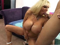 She's blonde and she has a pair of huge boobs! My slut knows, her melons make me horny as hell, so she doesn't waste my time and gets down and dirty. First, she bends over and rubs her ass on my cock, and then kneels, to have a taste of dick. Yeah, she's a slut and makes me wanna cum on her huge breasts!