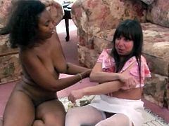 Caucasian lesbo helps her ebony lover put on a strapon. Later on she stands on her all four taking the harness in her slit from behind. Filthy lesbians fuck hard using big sex toy. Check this out.