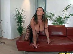 Sensual Jane is a naughty milfy woman who is proud of her gigantic boobs. She plays with her huge boobies and spreads her legs to to show her pussy, This big racked woman shows it all.