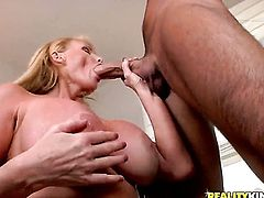 Voodoo gets pleasure from fucking Blonde with giant hooters in her hot mouth