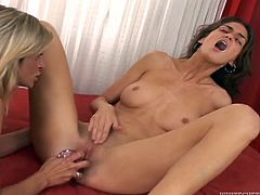 Kykola and Larisa are having fun in the living room. The brunette gets a dildo as a Christmas present and the bitches decide to test it.
