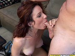 A slutty redhead fucker sucks on a hard cock and then gets it shoved balls deep into her snatch, check it out right here, it's fuckin' awesome!