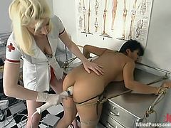 Slutty Asian girl Mika Tan is having fun with a blonde nurse. She lets her tie her up and stuff her snatch with wired things and enjoys a raunchy moment.