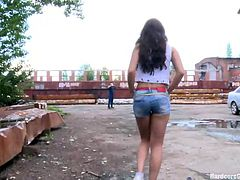 This bitch was walking like she owns the place but these men will own her! One of them approached her and soon the other come. They've grabbed her, took off her short jeans and panties in the same time and while two guys where holding her thighs a third one brutally fucked her pussy. Boy she will have some action