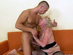 This insatiable granny needs a hard fuck to satisfy her hunger for sex. Horny stud bangs her twat in and out making her groan with pleasure.