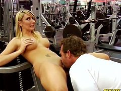 Engaging blonde milf Missy Woods is getting naughty with some man in a gym. She lets him finger her juicy pussy and then welcomes his prick in her warm depths.