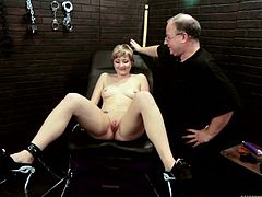 BDSM porn video with a steaming hot hick Nora Skyy! She gets on that seat and spreads her legs for a powerful fucking machine!