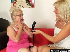 Oma-blondie gets abused with a strap on hammer worn by a orgastic domina madame who loves to shag elder women