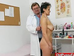 This time a busty brunette grandma named Marsa gets her hairy cunny examined plus a cold metal gyno-instrument by our eager and always curious Doc