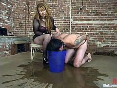 Brandon is having fun with chubby dominant milf Gabrielle in BDSM scene. The bitch drowns the guy in a bucket and beats him and then makes him lick her twat clean.