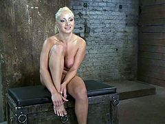 Sexy blonde Lea Lexis gets bound and suspended head over heels in a basement. Then some guy attaches leads to her amazing tits and fucks her juicy cunt with a dildo.