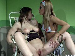 Blonde nurse examines pussy of her gf on a gyno chair