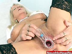 Huge natural titted older medical practical nurse gets undressed then touches her big tits and put various toys and medical instruments into her elder hole