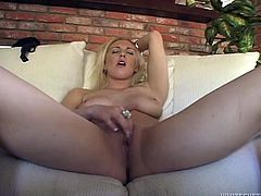 Provocative blonde is eager for orgasms and starts to masturbate her shaved slit. Later she involves her favorite dildo fellow in action.