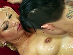 Dark haired Eva is about to give her girl a very special massage. She pours oil on her blonde and then, begins to rub her sexy body. Eva feels attracted by her, so soon she begins to lick that pussy. They form a hot 69 and take care of each other's cunts. Enjoy it!