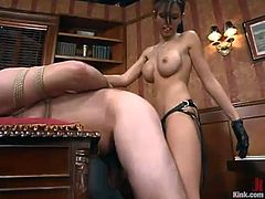 Frank Stone takes her suit off and gets her his dick tortured by sexy brunette mistress. Then she stuffs his ass with a strap-on from behind.