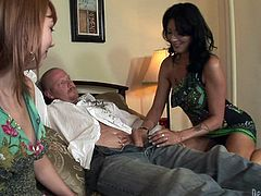 Zoey Holloway and Delila Darling give a handjob to bald dude. After that they suck his big dick and lick each others pussies.