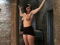 Charming brunette Brooke Lee Adams is having a good time with some dude in a basement. She gets immobilized by the guy and loves having weights on her beautiful natural tits.