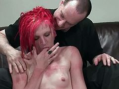 Tattooed chick with red hair strips her clothes off and gets tied up. Later on she also gets her vagina fingered and toyed deep.