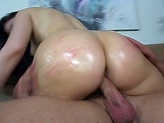 Check out Caroline Pierce's ass all oiled up and enjoy seeing it bouncing over a cock with the lust proper of a total slut.