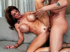 Luscious brunette MILF Deauxma has got huge fake boobs. She moans wild while her pussy hole is pounded hard from behind. Enjoy watching this high quality porn video presented by Naughty America.