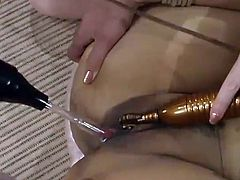 Kinky Asian chick lie naked on a couch with her legs opened. She gets her pussy stimulated with electricity and toyed with big dildo.