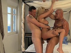 See Donna Bell and her big firm tits as she gets fucked by two cocks and gets even double penetrated in a threesome.