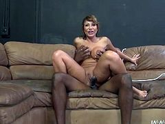 Kinky milf Ava Devine is having fun with horny black stud Lee Bang on a sofa. She gives a hot blowjob to the dude and then takes a great ride on his dick.