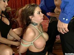 Brunette girl in stockings gets tied up and tortured with claws. Then she gets fingered by another girl and fucked by bald guy with big dick.