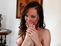 Silvia Saint and Esmeralda pose in sexy corsets and stockings. Then the lick each others feet. After that they start to shove their toes in their pussies.