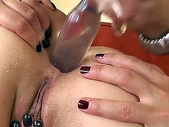 Young adorable Eufrat Mai with natural boobs and pretty face gets sweet asshole stuffed with vibrator by nasty Nataly Von in stockings in memorable bedroom action filmed in close up.