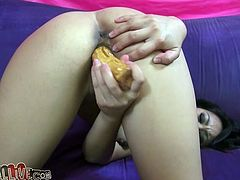 Nice Asian girl toys her tight pussy with a dildo. After that she sucks big cock and gets her sweet pussy licked in 69 position.