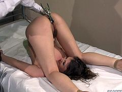 Horny patient gets her fine ass spanked with a wooden stick