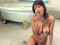 Impressive asian beauty gets nailed right and covered in warm jizz
