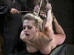 This juicy and busty blond siren got a fine ass. But this porn video is not about her ass. It's about how long she can stand being hogtied.