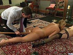 Tied up blonde girl gives great blowjob to her master and gets her pussy stuffed with a stick. later on she licks Cherry Torn's pussy.