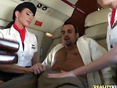 Mr. Bauterman was taking another long flight on his private plane.  The attendants were looking super hot in those tight skirts and stockings.  Mr. Bauterman enjoyed mistreating the help and often harassing them.  They finally got fed up with him and decided to teach him a lesson.  They ripped off his clothes to make fun of his little cock.  They were surprised by his big dick and decided to take turns sucking on it.  They made him eat their sweet pussies and then took turns getting their twats pounded.  They demanded man juice all over their faces and they got it.