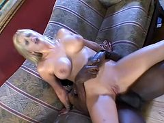 Watch this slutty blonde being nailed by a big black cock in this hardcore scene until her face's covered by cum while her cuckold man watches.
