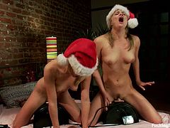 It's Christmas and Chloe Camilla and Isis Love are going to celebrate it by playing with sybians to reach christmasy orgasms!