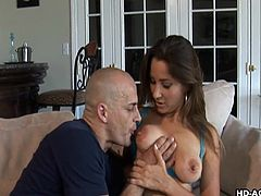 This babe is ready to get nasty with her boyfriend. She shows him her tits and then the two get down to fucking. She takes off her bikini and deepthroats his cock. He spreads her pussy wide and sticks his fingers in there.