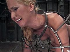 The gorgeous blonde is going through some pretty fucked up bondage in this lesbian femdom video that includes some forms of torture too.