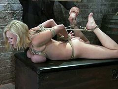 Curvaceous blonde girl gets tied up and gagged. She gets her tits twisted with ropes and then she gets her juicy pussy toyed deep.