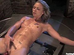 This slender and cute blond babe gets belted on that table and blindfolded. Then somebody sets that machine in between her legs and runs it!
