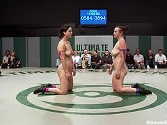 Hot brunettes fight in a two versus two battle. Girls from the losing team lick pussies and then get fingered by winning chicks.