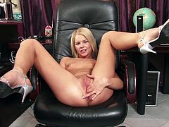 Lovely blonde babe strips her clothes off and sits down on an armchair. She spreads her sexy legs and finger fucks herself.