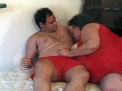 This old and fat life guard hits on a younger man by admiring his big belly. She touches him lover and rapidly engulfs his cock. He pounds her really fat cunt.