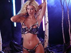 Amazingly hot blonde girl in pink lingerie and high heels lies down on the bed. She demonstrates her appetizing boobs and clean shaved pussy.